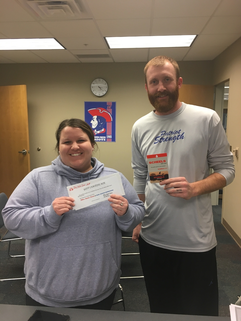 Ms. McGaffee and Mr. Wiertzema holding the winnings!